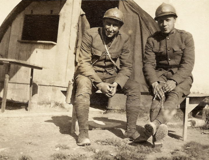 """Two fools laughing at a camera on a box."" Rupert Lindsey and co-driver Mac, Champagne-Ardennes, October 1917."